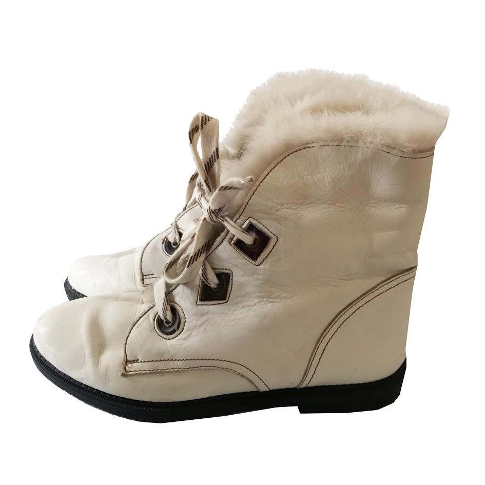 Accessoires - Boots blanches fourrure