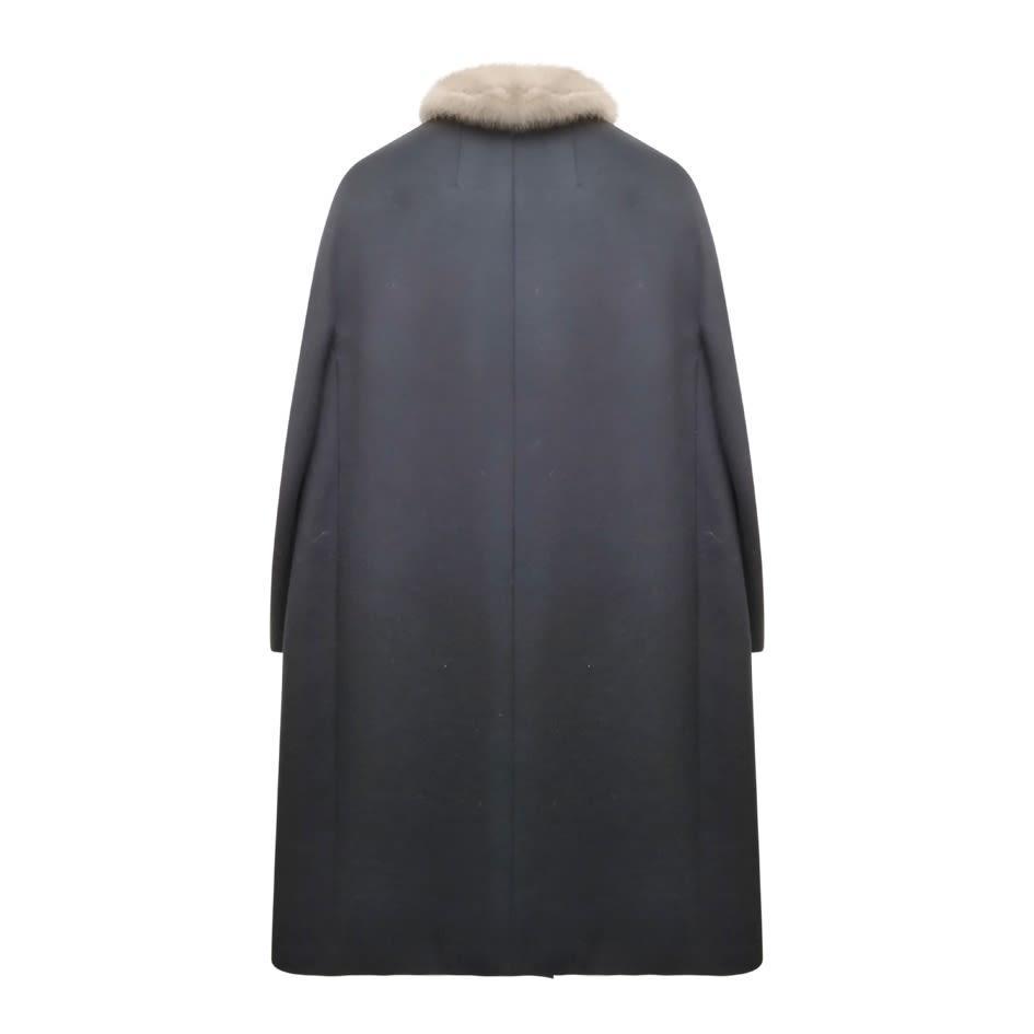 Manteaux - Manteau en laine et fourrure