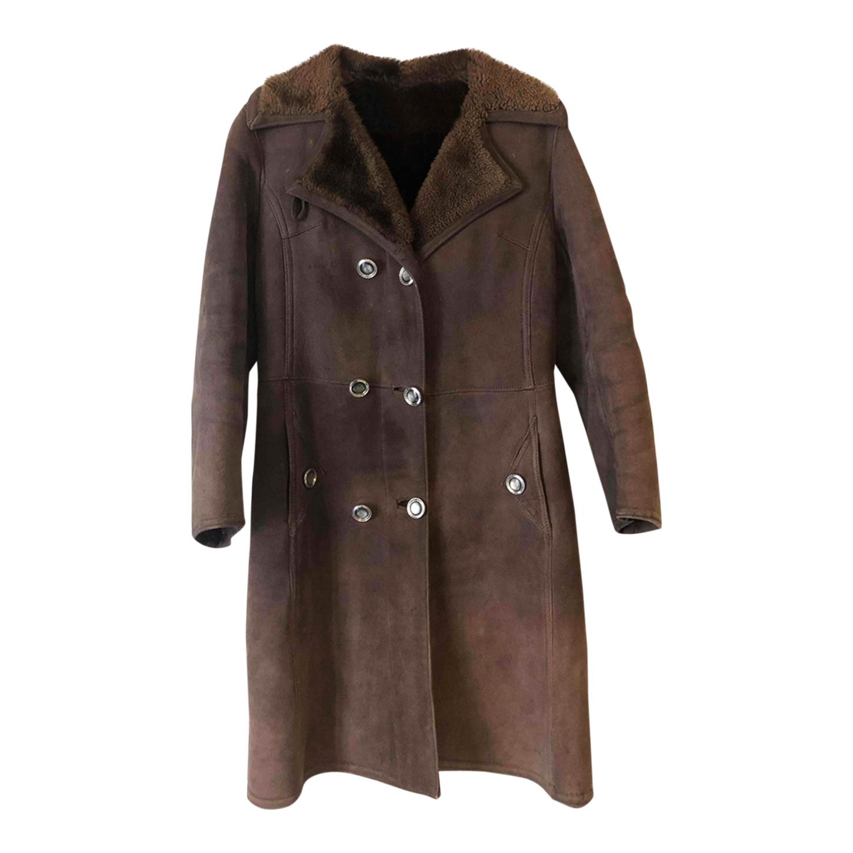 Manteau long en peau lainée