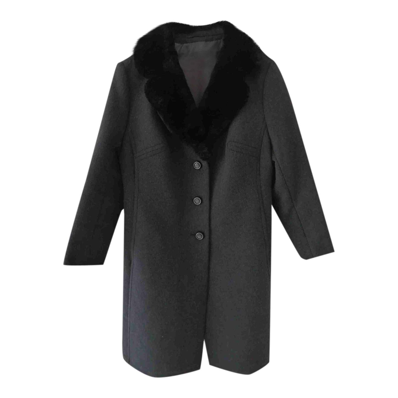 Manteau à col en fausse fourrure