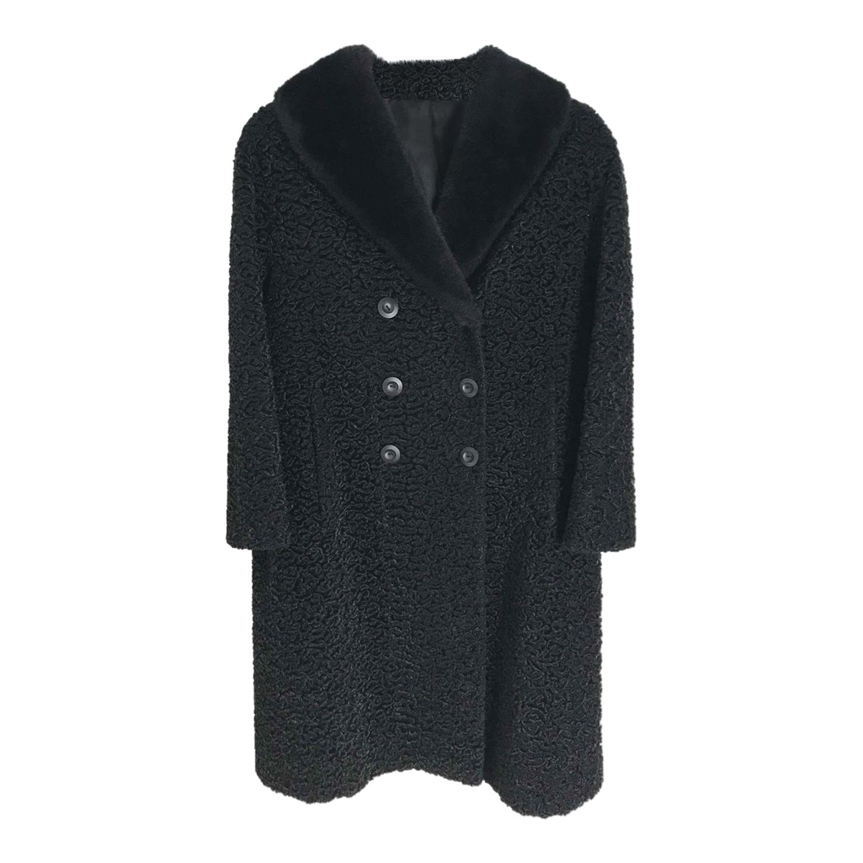 Manteau noir en laine texturée