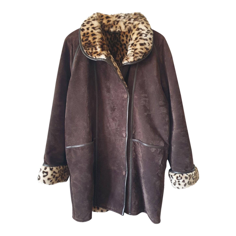 Manteau en daim et fausse fourrure