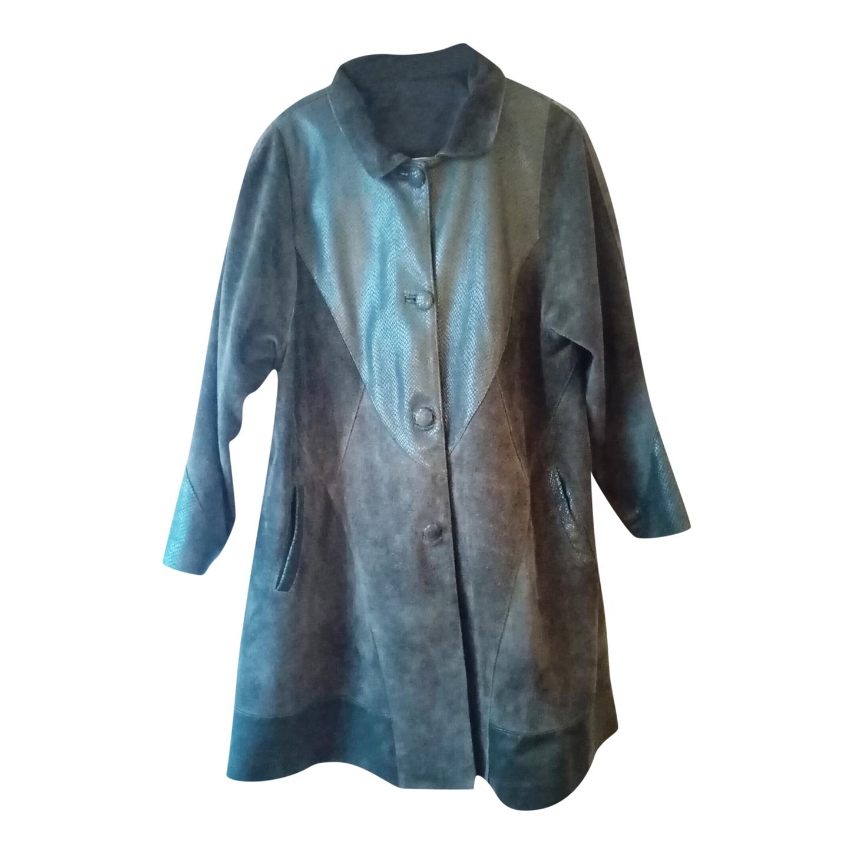 Manteau en cuir et daim