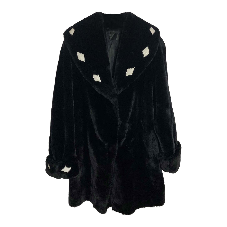 Manteau en fausse fourure