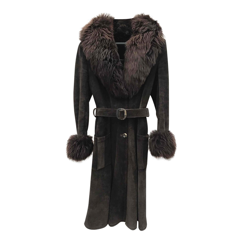 Manteau en daim et fourrure