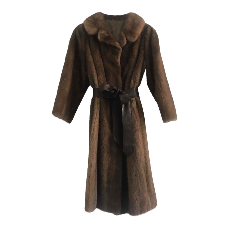Manteau en vison ceinturé