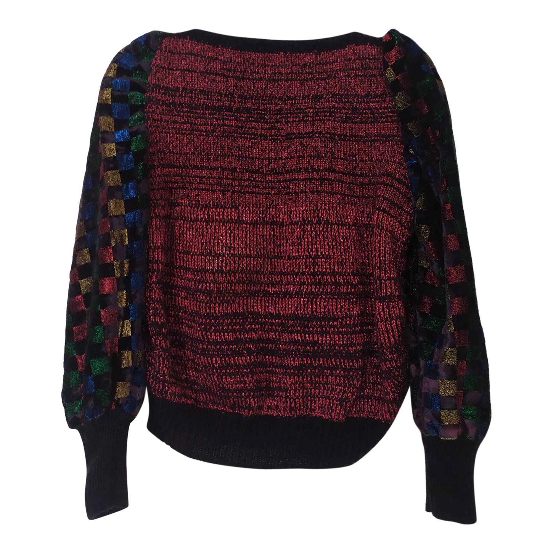 Pull court en laine et velours