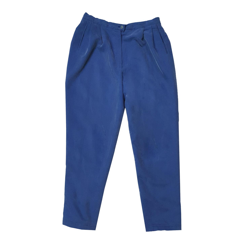 Pantalon à pinces en velours côtelé