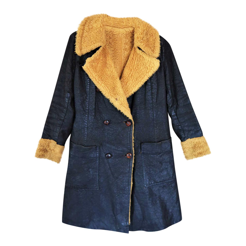 Manteau en cuir et fausse fourrure