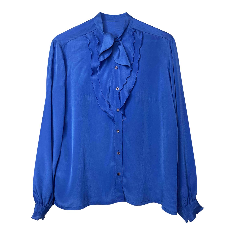 Chemise bleue à volants