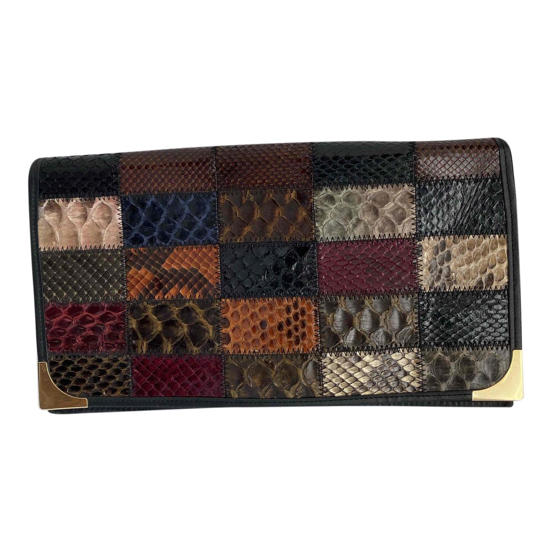 Pochette en patchwork de cuir