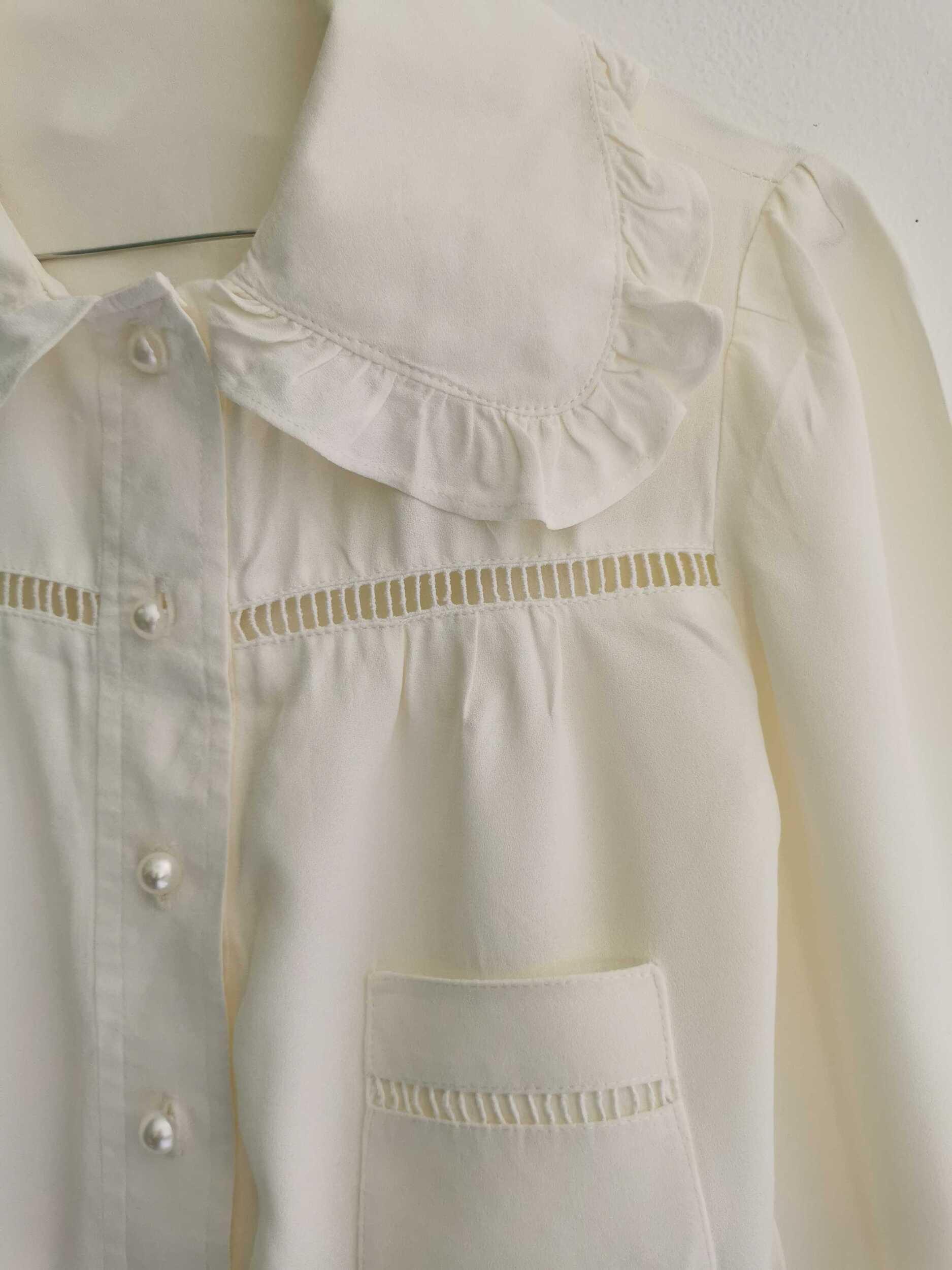 Chemise courte à grand col