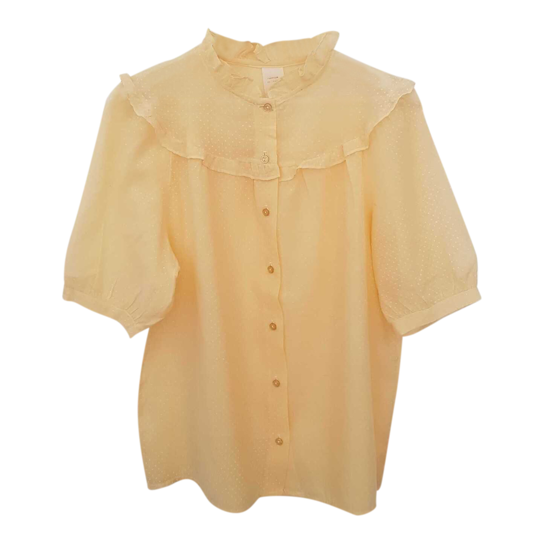 Blouse jaune pastel