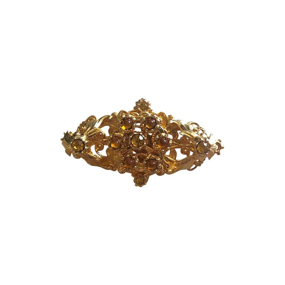 Broche en métal doré