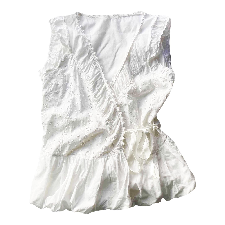 Cache-coeur en coton brodé