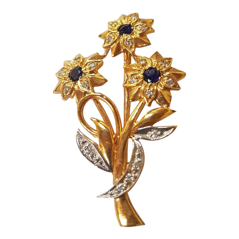Broche dorée à fleurs