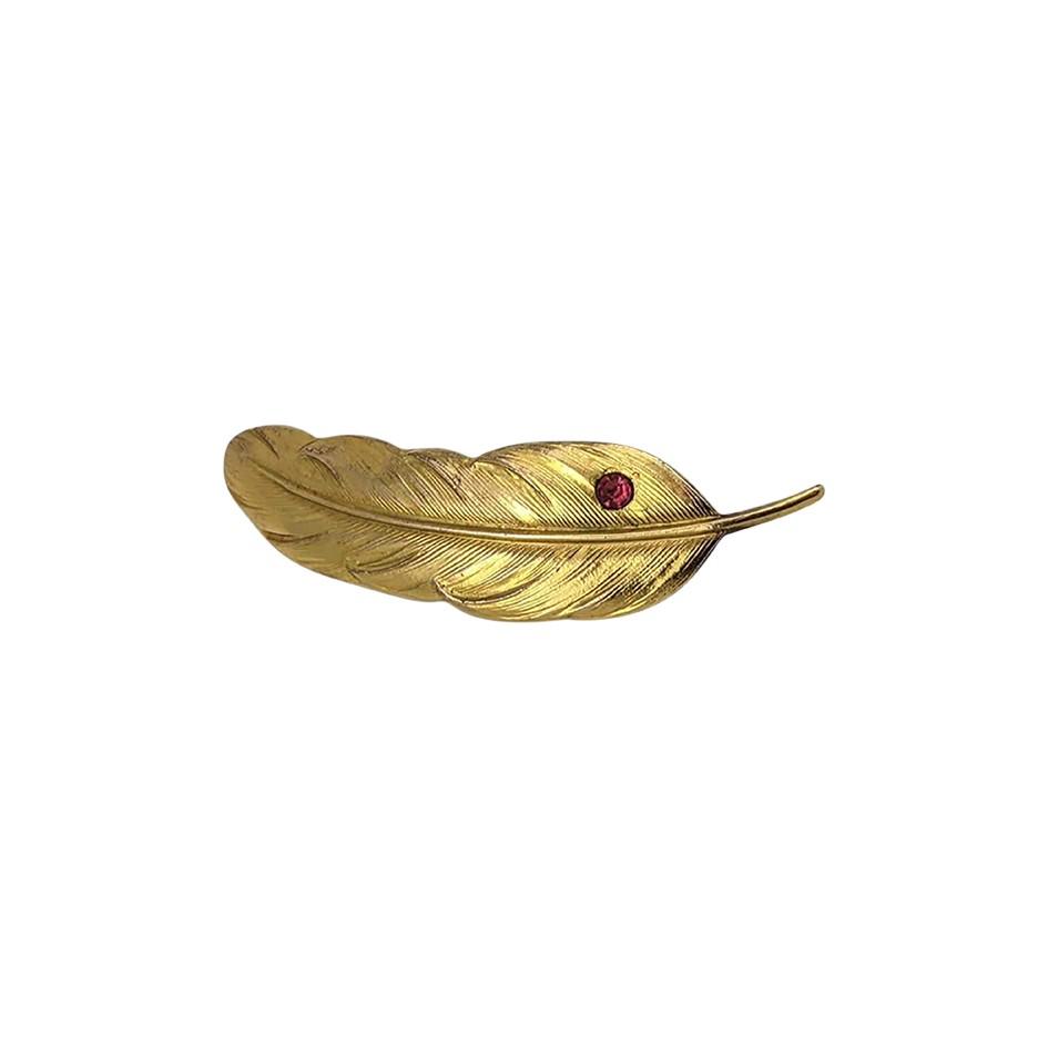 Broche plume