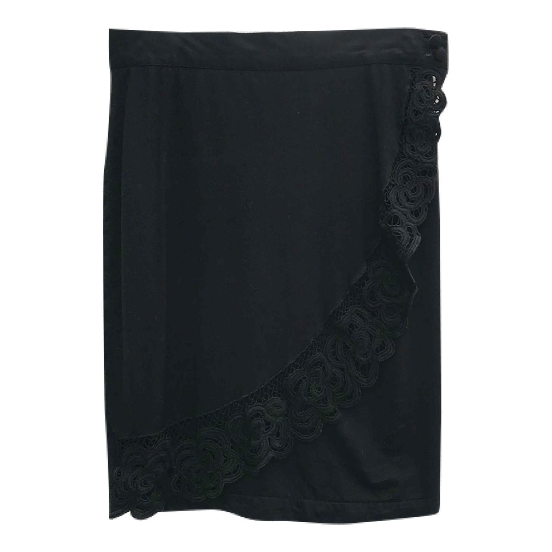 Jupe noire portefeuille