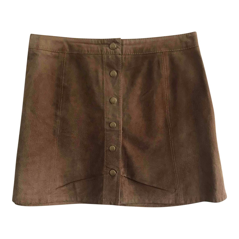 Mini- jupe en daim boutonnée