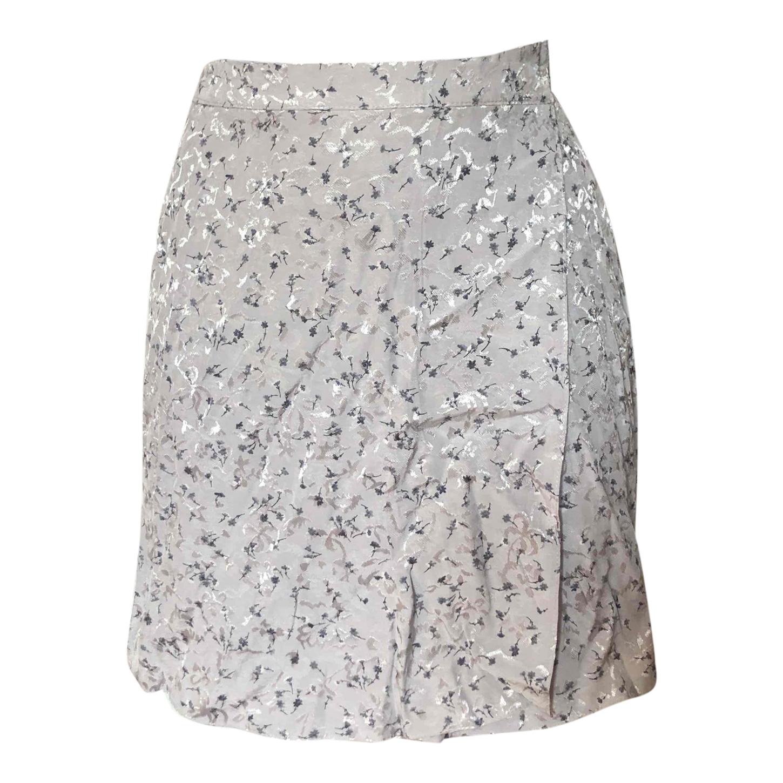 Mini-jupe portefeuille satinée
