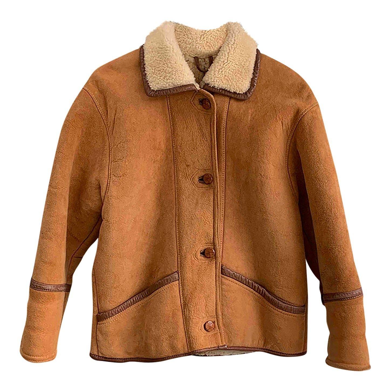 Manteau en peau lainée